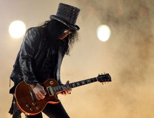 ARLINGTON, TX - FEBRUARY 06: Slash performs with the Black Eyed Peas during the Bridgestone Super Bowl XLV Halftime Show at Cowboys Stadium on February 6, 2011 in Arlington, Texas. (Photo by Ronald Martinez/Getty Images)